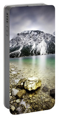 Landscape Of Plansee Lake And Alps Mountains During Winter, Snowy View, Tyrol, Austria. Portable Battery Charger