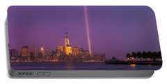 Portable Battery Charger featuring the photograph Laser Twin Towers In New York City by Ranjay Mitra