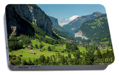 Portable Battery Charger featuring the photograph Lauterbrunnen Mountain Valley - Swiss Alps - Switzerland by Gary Whitton