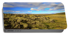 Lava Fields Of Iceland Portable Battery Charger by Allan Levin