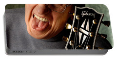 Les Paul With Tongue Out By Gene Martin Portable Battery Charger
