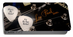 Les Paul's Guitar Pick On Gibson Headstock By Gene Martin Portable Battery Charger