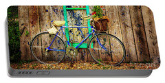 Portable Battery Charger featuring the photograph Lewistown Garden Bicycle by Craig J Satterlee