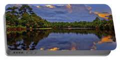 Light Beam Sunset Over Hidden Lake In Jupiter Florida Portable Battery Charger