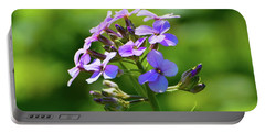 Portable Battery Charger featuring the photograph Light Purple Flowers  by Lyle Crump