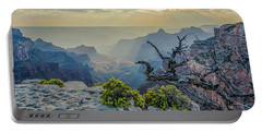 Portable Battery Charger featuring the photograph Light Seeks The Depths Of Grand Canyon by Gaelyn Olmsted