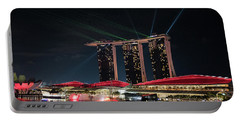 Light Show On Singapore Harbour Portable Battery Charger by Jocelyn Kahawai