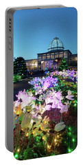 Portable Battery Charger featuring the photograph Lighted Flowers by Liza Eckardt