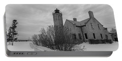 Portable Battery Charger featuring the photograph Lighthouse And Mackinac Bridge Winter Black And White  by John McGraw