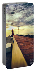 Portable Battery Charger featuring the photograph Lighthouse At Sunset by Silvia Ganora