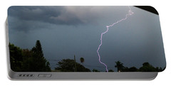 Portable Battery Charger featuring the photograph Lightning Bolt Illuminates The Sky by Vincent Billotto