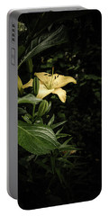 Portable Battery Charger featuring the photograph Lily In The Garden Of Shadows by Marco Oliveira