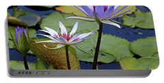 Portable Battery Charger featuring the photograph Lily Trio by Judy Vincent