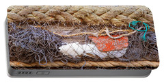 Portable Battery Charger featuring the photograph Line Of Debris by Stephen Mitchell