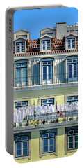 Lisbon Laundry Portable Battery Charger by Marion McCristall