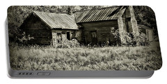 Portable Battery Charger featuring the photograph Little Red Farmhouse In Black And White by Paul Ward