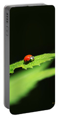 Little Red Ladybug On Green Leaf Portable Battery Charger by Christina Rollo