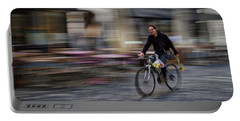 Portable Battery Charger featuring the photograph Ljubljana Bicycle Rider - Slovenia by Stuart Litoff