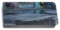 Portable Battery Charger featuring the photograph Ljubljana Graffiti Reflections #2 - Slovenia by Stuart Litoff