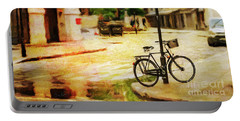 Portable Battery Charger featuring the photograph London Street Bicycle by Craig J Satterlee