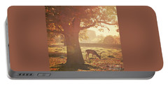 Portable Battery Charger featuring the photograph Lone Deer by Lyn Randle