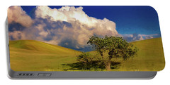 Lone Tree With Storm Clouds Portable Battery Charger