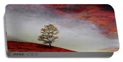 Portable Battery Charger featuring the painting Lonely Tree by Judy Kirouac