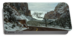 Portable Battery Charger featuring the photograph Lonesome Snowy Winter In Zion by Gaelyn Olmsted