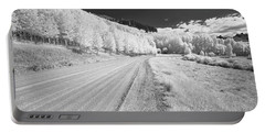 Portable Battery Charger featuring the photograph Long Road In Colorado by Jon Glaser
