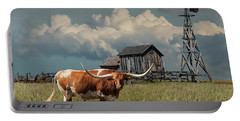 Longhorn Steer In A Prairie Pasture By Windmill And Old Gray Wooden Barn Portable Battery Charger by Randall Nyhof