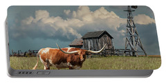 Longhorn Steer In A Prairie Pasture By Windmill And Old Gray Wooden Barn Portable Battery Charger