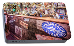 Portable Battery Charger featuring the photograph Luckenbach Bar by Andy Crawford
