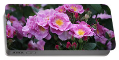 Portable Battery Charger featuring the photograph Lucky Floribunda Roses by Rona Black