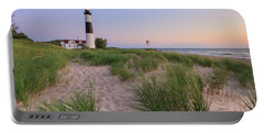 Portable Battery Charger featuring the photograph Ludington Beach And Big Sable Point Lighthouse by Adam Romanowicz