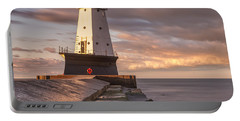 Portable Battery Charger featuring the photograph Ludington North Breakwater Light At Dawn by Adam Romanowicz