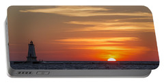 Portable Battery Charger featuring the photograph Ludington North Breakwater Light At Sunset by Adam Romanowicz