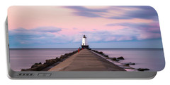 Portable Battery Charger featuring the photograph Ludington North Breakwater Light Sunrise by Adam Romanowicz