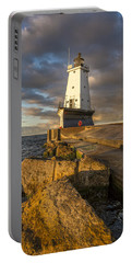 Portable Battery Charger featuring the photograph Ludington North Breakwater Lighthouse At Sunrise by Adam Romanowicz