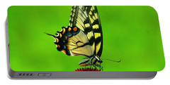 Portable Battery Charger featuring the photograph Lunchtime by Byron Varvarigos