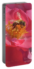 Portable Battery Charger featuring the photograph Luscious Rose With A Bee by Nancy Lee Moran