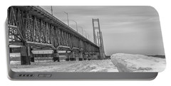 Portable Battery Charger featuring the photograph Mackinac Bridge Icy Black And White  by John McGraw