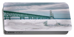 Portable Battery Charger featuring the photograph Mackinac Bridge In Winter During Day by John McGraw