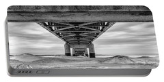 Portable Battery Charger featuring the photograph Mackinac Bridge In Winter Underneath  by John McGraw