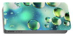 Portable Battery Charger featuring the photograph Macro Water Droplets Aquamarine Soft Green Citron And Blue by Sharon Mau