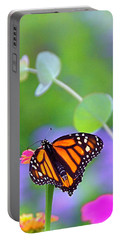 Portable Battery Charger featuring the photograph Magical Monarch by Byron Varvarigos