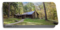 Portable Battery Charger featuring the photograph Malabar Cabin by Lon Dittrick