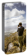 Male Tourist Taking Photo On Mountain Top Portable Battery Charger