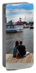 Man And Woman Sitting On Dock Portable Battery Charger