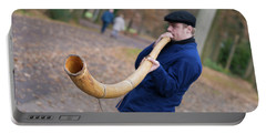 Man Blowing Horn Portable Battery Charger