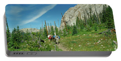 Man Hiking With Two Llamas High Alpine Mountain Trail Portable Battery Charger